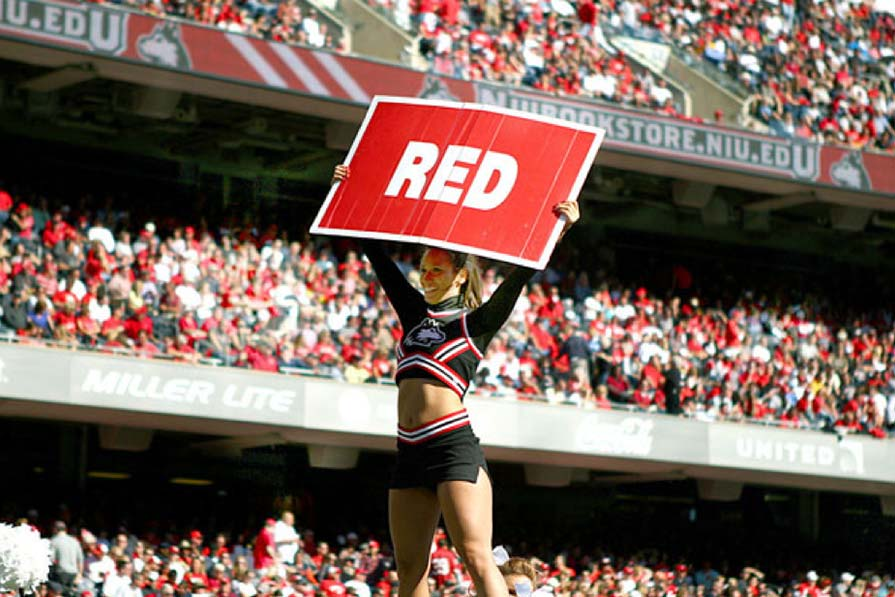 Cheerleader holding sign
